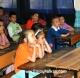 Kapsa teaching children at local school about animals
