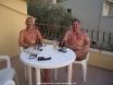 the men waiting for the women to put their faces on for an evening out in kalkan